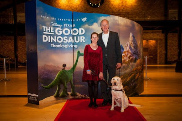 GDB alumna Jane Flower and her guide dog Anja at Pixar Headquarters with a Pixar executive.