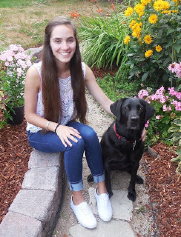 Mikeala with a black Lab