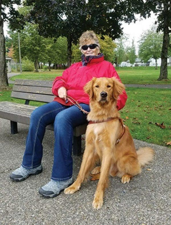 Sandra Shelby with her Golden Retriever guide dog, Neptune.