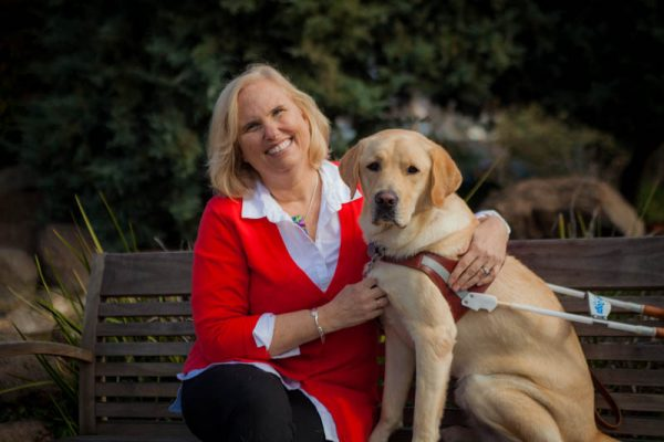 Theresa Stern with her yellow Lab guide dog, Wills.